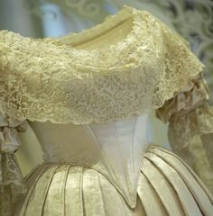 Experts have been carrying out conservation work on the dress's fragile silk satin and lace trimming. By wearing a fashionable white, silk satin court dress instead of her robes at the wedding, the Queen diverged from protocol. The simpler style set a pattern for royal wedding dress which survives to this day.Picture: MIGUEL MEDINA/AFP/Getty Images