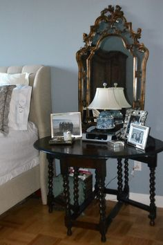 An antique gate leg table for a night stand