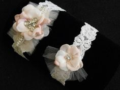 Garters don't have to be typical gathered satin or lace. This garter set has a flower fascinator, tulle details with crystal rhinestones one a stretch lace for a smooth look not a gathered lace. A BEST SELLER