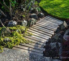 s 17 amazing garden features we ve been saving for spring, gardening, outdoor living, ponds water features, Her sweet simple pallet plank walkway