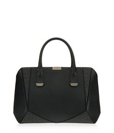 <p>Snake and studs – this luxury handbag is for the Bendel Girl with an apologetic edge. Crafted with exotic snake embossed leather embellished with stud detailing, the Studded Geo Tote features satin lining, signature Henri Bendel hardware and feet, as well as a removable shoulder strap for edgy toting all across the globe.</p>
