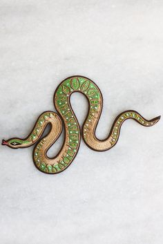 """A slithering snake based on an original acrylic painting by Lisa Vanin. Embroidered patch with iron-on backing. Measures larger than our usual patches at 6 3/4"""""""