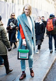 Jane Keltner de Valle wears her colors bold and bright with a red blouse and green colorblock top-handle purse.