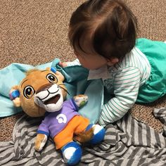 Leo the Lion with his new friend. Perfect toy for kids with hearing aids!