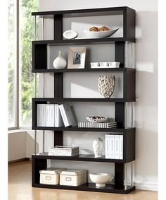 Function and design combine to make this bookcase a fun, new way to decorate the home. Use it to display photographs, souvenirs from globetrotting adventures or favorite books. With playful and contemporary lines, it'll add more storage space in a very stylish way.   Adult Assembly Required due to the presence of small parts
