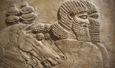 Detail of an Assyrian relief from Nimrud, Iraq, showing horses and horsemen of the royal chariot, 725 BCE. Photograph: Steven Vidler / Eurasia Press