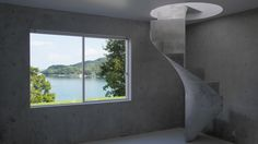 A concrete staircase spirals between the austere concrete floors of this house designed by Kazunori Fujimoto Architect & Associates for a seaside spot in Japan's Hiroshima Prefecture.