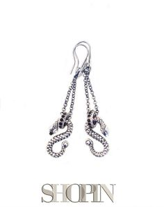 This Shopin earrings feature a Snake pendant with a scaly surface and a round hook with zircons.  Rhodium plated bronze, black and white zircons. Nickel free and hypo-allergenic. Made in Italy.