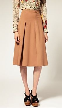 Own the Midi Skirt Trend With These Killer Silhouettes