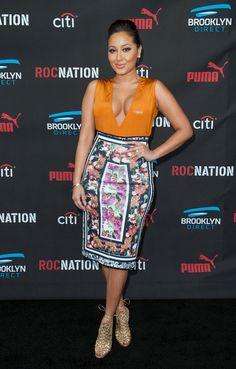 Adrienne Bailon Gladiator Heels - Adrienne Bailon paired her cute dress with chic gold gladiator heels.