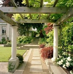 Ron Herman Landscape Architect - A free-standing pergola leads you through the garden, a living roof creates a perfect transition from crisp lawn to lush border.