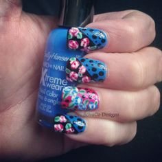Nail Art Roundup: Easy DIY Nail Designs Black tip with floral and polka dots. #naildesign #nailart