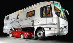 This is literally a motorhome. A car lives inside this thing.  Holy Overconsumption Batman!!!
