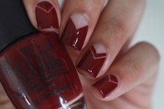 We love this red violet, negative space manicure. Get the look with OPI's Malaga Wine and So Easy Stripe 'Em.
