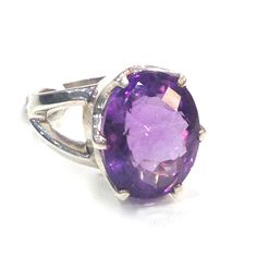 Amethyst will help to balance those emotional highs and lows Sterling silver ring featuring 16 x 12mm oval checkerboard cut Amethyst. Bezel setting with split shank Size 8.5 or Q1/2 This ring may be re-sized...