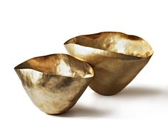 Bash Vessel is formed of brass and shaped by hand into an expressive crumpled form. It can be used as an extravagant flower vase, fruit bowl or as a contemporary sculpture.  Each piece is unique in shape and finished with a gold wash. Also available in Large.