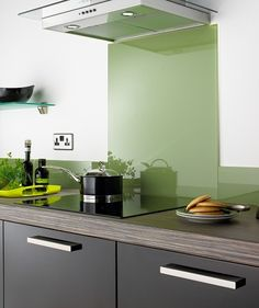 Green glass splash back to go in cream kitchen