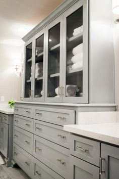 Drawers and Glass Enclosed Cabinet Shows Off Pretty Linens