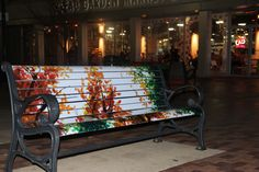 This hand painted bench brings color to the downtown area.