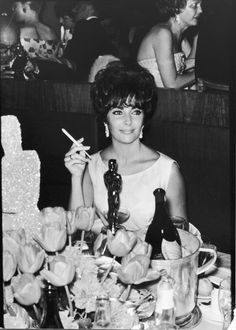 Elizabeth Taylor at a party after winning the Oscar for her performance in <em>BUtterfield 8</em>, 1961.