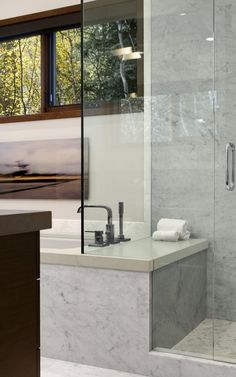 Bathroom inspiration: The bench in the shower that is a part of the tub surround, and the great window placement.