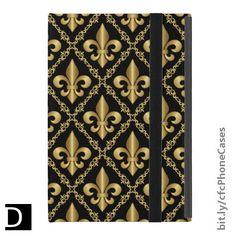 This Powis iPad Mini case features an elegant pattern of golden fleur-de-lis symbols inside of a diamond-shaped lattice of decorative scrollwork on top of a black background. #StudioDalio #ipad #fleurdelis #fleurdelys #blackandgold
