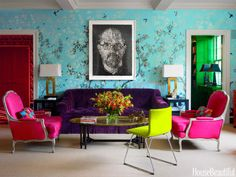 In the living room, the juxtaposition of a self-portrait by artist Chuck Close against a flowery chinoiserie wallpaper, Iksel's Eastern Eden, immediately signals that this is not formula decorating. The jewel tones of the Holland & Sherry velvet on the custom sofa by Luther Quintana, the Sequana fabric on vintage French bergères from Duane, and the leather on Ikea's Bernhard chair give the room character. Lamps, Gracious Home. Carpet, Patterson Flynn Martin.