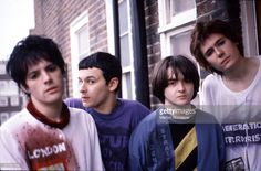 Group portrait of the Manic Street Preachers at Martyn Goodacre's flat, Old Kent Road, London, January 1991. L-R Richey Edwards, James Dean Bradfield, Sean Moore and Nicky Wire.