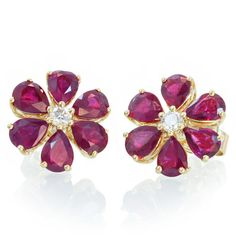 18k yellow gold 2.93 carats tw, natural rubies and diamonds. These earrings are stunning in softness design to its gorgeous quality, simple and yet well dressed, casual or for your evening, they will scream for compliments.