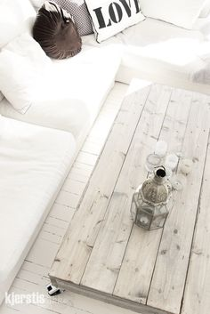 Reclaimed wood accents with flat light colored stucco could be an option (see table)