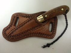 http://leathersmithmike.com/sv-sheaths/images/cross%20draw%20sheath.jpg