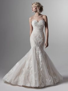 Sottero and Midgley by Maggie Sottero Chic lace motifs waltz over textured tulle in this wedding dress, adorning the sweetheart neckline. Lace motifs drift over the hemline, com Sottero And Midgley Wedding Dresses, Strapless Lace Wedding Dress, Sheath Wedding Gown, Luxury Wedding Dress, Designer Wedding Dresses, Bridal Dresses, Wedding Gowns, Sottero Midgley, Wedding Venues