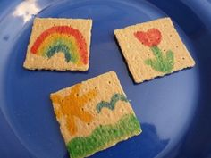 Edible Cracker Canvas  What You Need:   Graham Crackers   White Grape or Apple Juice   Food Coloring (natural food coloring is ideal)   Small Paintbrushes     Mix a couple tablespoons of juice with several drops of food coloring.