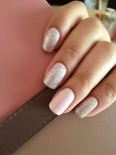 Silvery sparkle polish with one light pink nail.