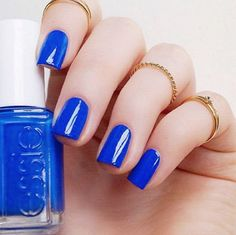 Indulge in a bright blue 'butler please' manicure that simply adores being waited on hand and foot.