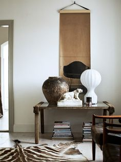 Warm and Unique…k..…..the scroll has an Asian vibe with an Eames chair for a modern twist.