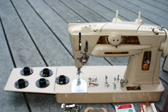 Singer 401G.  Make in Germany.  all the knobs on the front of this machine look familiar.