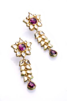 Entice kundan polki floral earrings with pinkish-purple tourmaline.