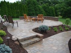 raised outdoor patios - stamped concrete