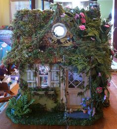 Beautiful fairy house! love the details - such a sweet little fairy-tale cottage look - perfect! (Pinner believes the artist may be fairy furnishings on Etsy as well)