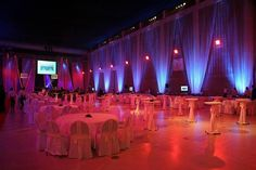 banquet room with blue uplighting and drapes