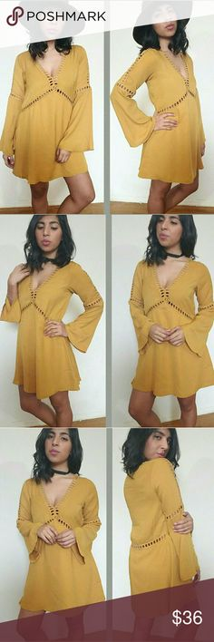 |new | MUSTARD CROCHET TRIM TUNIC DRESS Hubba hubba! Love this cutie. Color is a golden mustard. This is a long bell sleeve dress with a plunging neckline and crochet trim detail. It has a lined skirt and top part is unlined but nothing can be seen. Crochet trim runs down the front and swings around the back. Has a flowy feel. Fits TTS.   Sizes available:  S M l Modeling size Medium   PRICE FIRM UNLESS BUNDLED   Dresses