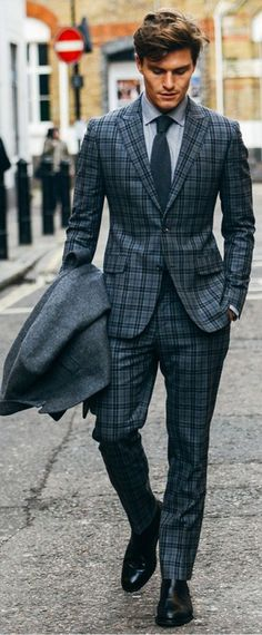 Single-breasted two-button plaid. Well tailored.
