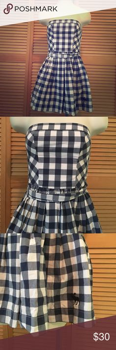 "Abercrombie plaid pleated strapless mini dress New with tag Abercrombie dress in size XS. Blue and white gingham plaid. Matching belt. The belt is separate from the dress (not connected). It is lined. 100% cotton. Elastic stretch back. Pleating at waist for adorable outward flair. Laying flat measurements: 12"" across top (before stretch--approximately 1""), 11.5"" waist (before stretch),  about 14.5"" from waist down, 23.5"" total length Abercrombie & Fitch Dresses Strapless"