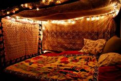 found on tumblr. Super cute way to make your bed so cozy! #cozy #bedroom #lights