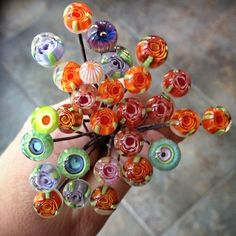 This morning's kiln harvest. Lots of flowers. Not too shabby for having to take lots of breaks. #lampwork #headpins #glassaddictions #beadfestphilly | Flickr - Photo Sharing!