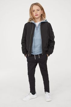 Pull-on pants in stretch cotton twill. Elasticized drawstring waistband and mock fly, side pockets, and mock back pockets. Boy Haircuts Long, Boy Hairstyles, Tomboy Kids, Navy Blue Shirts, Checked Trousers, Light Blue Jeans, Pull On Pants, Black Kids, Long Jackets