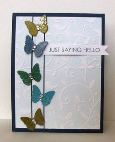 handmade card ... column of punched butterflies ... luv the subtle use of the inked embossing folder technique ... light blue on the flat side makes it look like a Wedgewood piece of china ... luv it!
