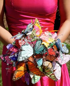 I'm Not a flower type girl and my obsession of butterfly was a huge part of my enchanted forest wedding.  Handmade butterfly bouquets for all 7 of my beautiful bridesmaids.  They will never dye, and make amazing centerpieces and keepsakes.