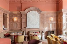 Salmon-coloured surfaces, curved furnishings and a cooking-themed wall mural appear inside high-end restaurant Hélène Darroze at The Connaught, which has been recently refreshed by Pierre Yovanovitch. Wooden Wall Panels, Wood Panel Walls, Wood Paneling, Damien Hirst, Pierre Yovanovitch, Mayfair, Terrazo, Oak Dining Table, Banquettes
